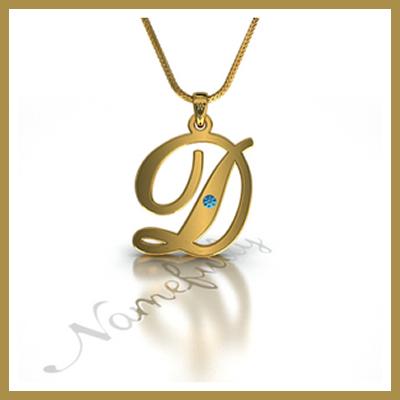 Le collier en or portant l'initiale D était une tradition chez les Demba. Transmise de génération en génération du père au fils ainé. The Bridge MAG. Image