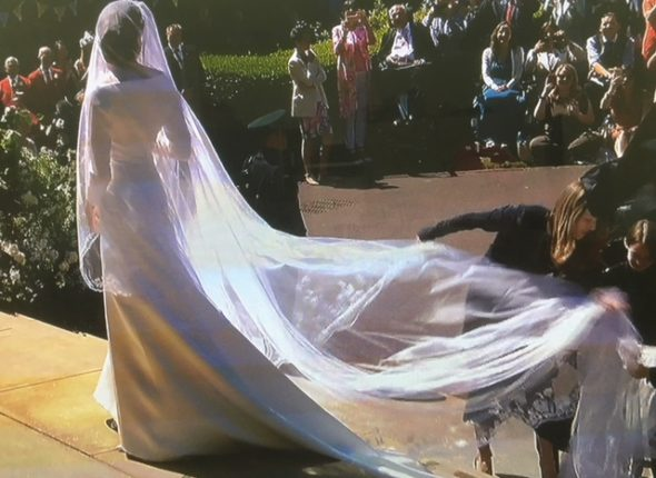 First glimpse at Meghan Markle now Duchess of Sussex Givenchy wedding dress designed by Claire White Keller The Bridge MAG. Image