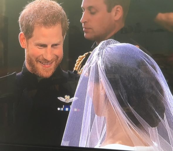 Prince Harry gazing at his beautiful bride full of joy. The Bridge MAG. Image